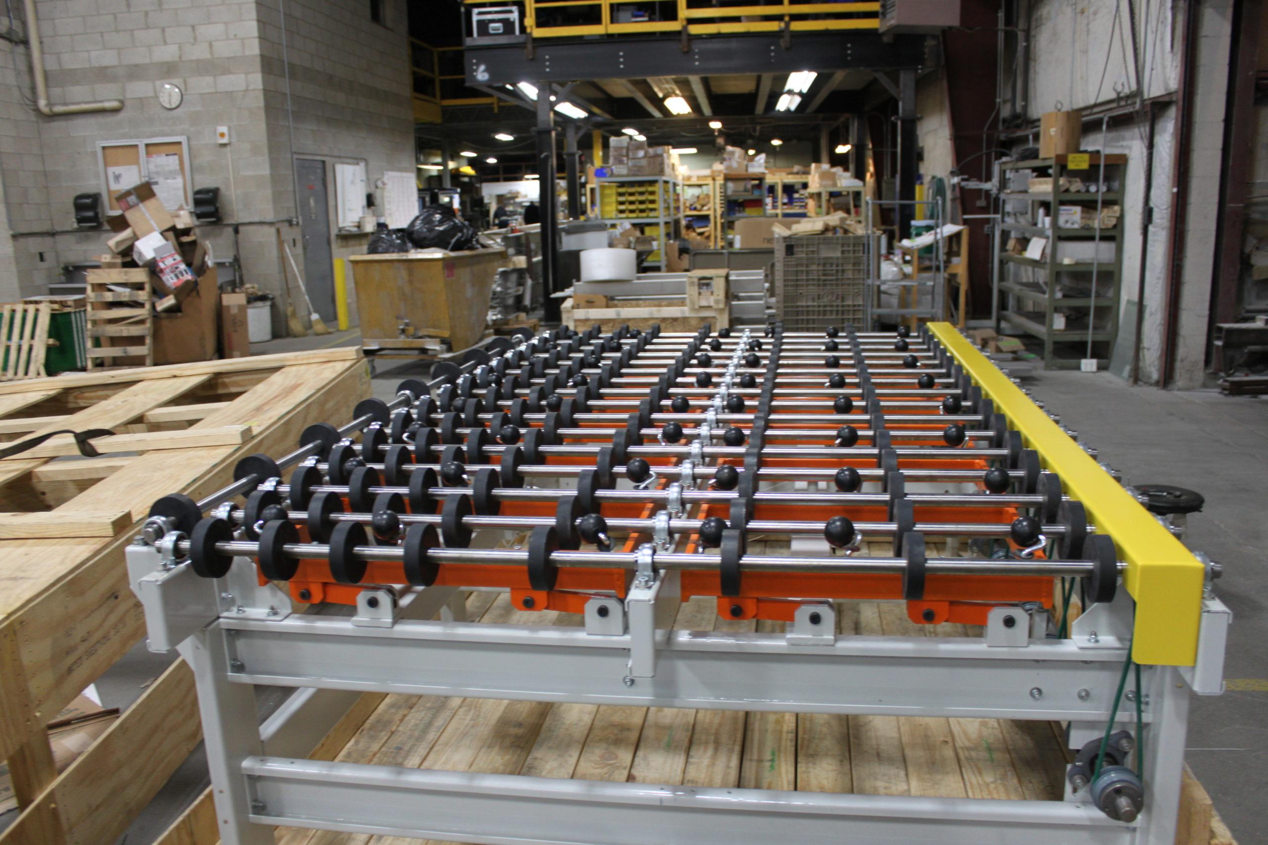 Roller Conveyor with popup caster table - Glassline